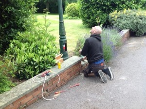 John preparing the lamp post for switch on
